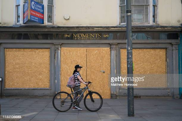 Boarded up shops on Newport high street on April 19 2019 in Newport United Kingdom Large numbers of high street stores across the UK have closed as...