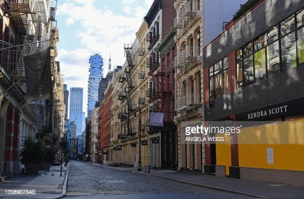 Boarded up storefronts are seen in the SoHo neighborhood of New York City on April 1 2020 The US on Wednesday has surpassed 200000 confirmed cases of...