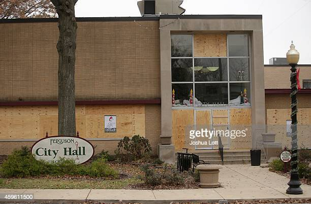 Boarded up windows are seen at Ferguson City Hall November 26 2014 in Ferguson Missouri Demonstrators continue to protest the shooting death of...