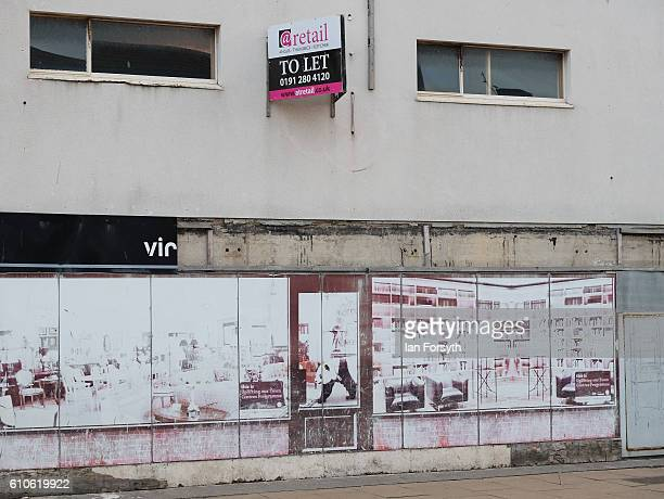 Boarded up windows are seen in a shop in Redcar high street on September 27 2016 in Redcar United Kingdom One year on since the SSI steel making...