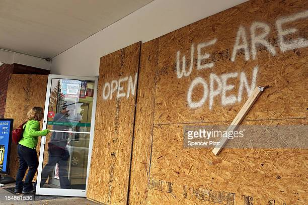 A boardedup store remains open for business as the first signs of Hurricane Sandy approach on October 28 2012 in Fairfield Connecticut The storm...