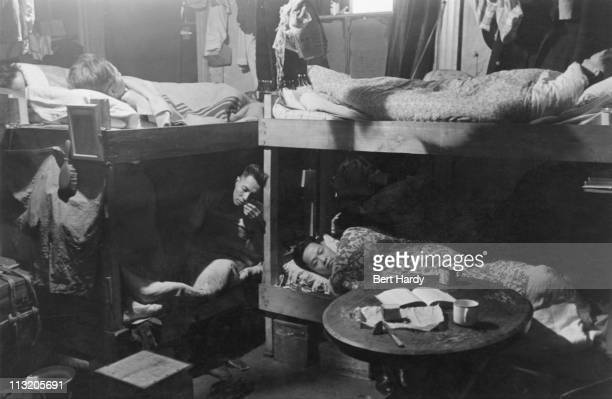 Boarders sharing a room at a hostel for Chinese people in Liverpool May 1942 Original Publication Picture Post 1136 Chinese Hostel Liverpool unpub