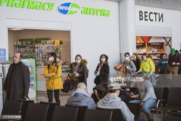 boarding a flight to new york during coronavirus pandemic - moscow russia stock pictures, royalty-free photos & images