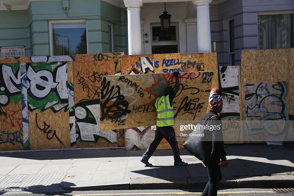 Boarding is erected in front of residential properties ahead of the annual Notting Hill Carnival, on August 26, 2016 in London, England. Many shops, businesses and residential properties are boarded up to prevent damage to their properties. More than one million people are expected to enjoy this year's Notting Hill Carnival. It is the largest street festival in Europe and was first held in 1964 by the Afro-Caribbean community. Over the bank holiday weekend the streets come alive to steel bands, colourful floats and costumed performers as members of the public flood into the area to join in the celebrations.