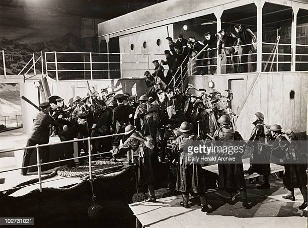 Boarding party 1940 A photograph of a scene from the British propaganda film 'For Freedom' showing British sailors from HMS 'Cossack' boarding the...