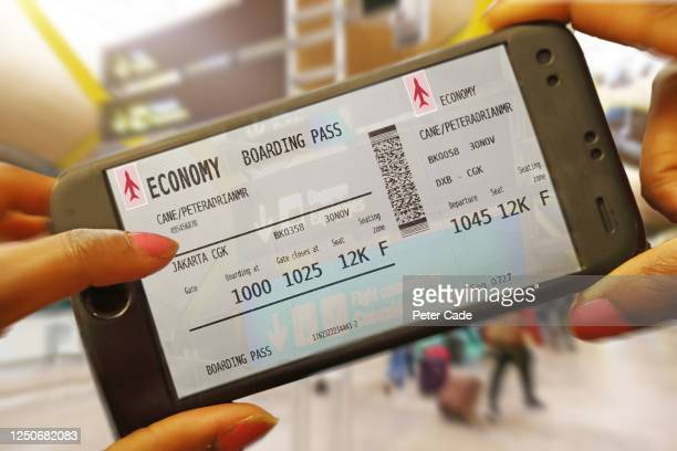 boarding pass on phone - western script stock pictures, royalty-free photos & images