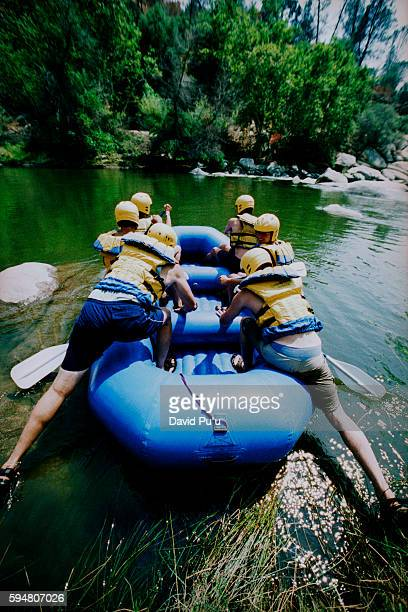 Boarding Raft on Bank of River