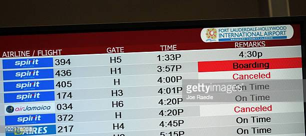 A boarding sign shows next to the Spirit Airlines Inc flight as it prepares to take off from the Fort Lauderdale International Airport after striking...