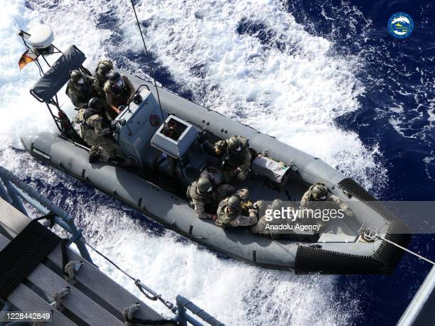 Boarding team arrives Merchant Vessel Royal Diamond 7, a ship carrying jet fuel from the United Arab Emirates to Libya's Benghazi, stopped to enforce...