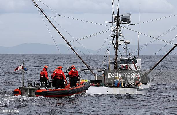 A boarding team from the US Coast Guard Cutter Hawksbill prepares to board a fishing vessel while on patrol in the Pacific Ocean off of the coast of...