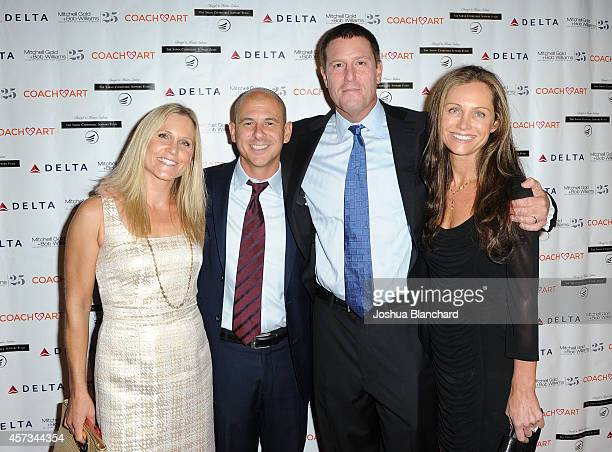 Boardmember at CoachArt Brent Weinstein honoree Kevin Mayer from the Walt Disney Company and their wives attend the CoachArt Gala Of Champions at The...