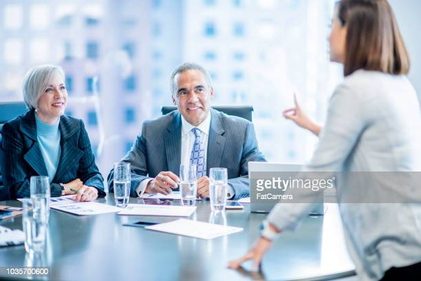 boardroom meeting - fatcamera stock pictures, royalty-free photos & images