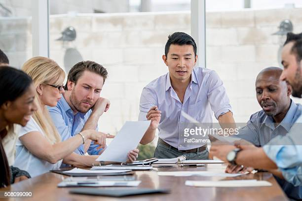 boardroom presentation - southern european descent stock pictures, royalty-free photos & images