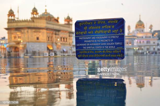 Boards announcing that photography and videography is strictly prohibited in the precincts of the Golden Temple are displayed in three languages in...