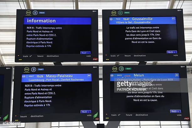 Boards bearing informations on the interruption of train traffic are pictured as the Paris rail link was suspended from and to Gare du Nord in Paris...