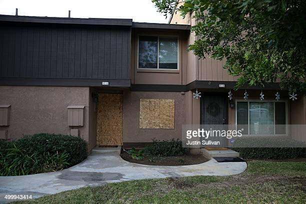 Boards cover the windows of the home of Syed Farook after police and FBI investigators raided the home searching for evidence on December 4, 2015 in...