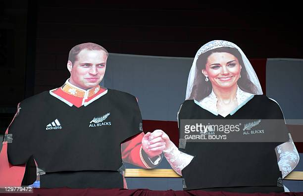 Boards depicting England's Prince William and his wife Kate Duchess of Cambridge wearing an All Blacks jersey are pictured at a balcony in Auckland...