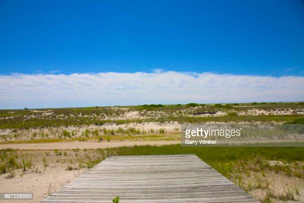 boards facing the sand dunes at jones beach, ny - wantagh stock pictures, royalty-free photos & images
