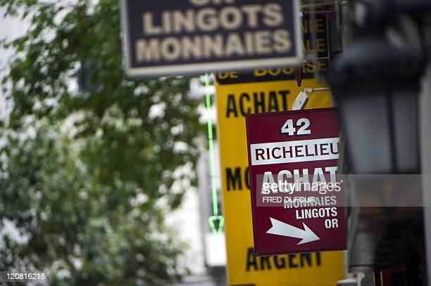 Boards of gold shops are seen in Paris on August 4 2011 Gold a traditional safehaven asset jumped to another record on August 3 2011 hitting an...