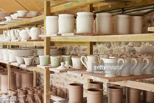 boards of pottery in potters workshop - richard drury stock pictures, royalty-free photos & images