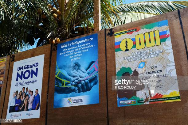 Boards with campaign posters by different political groups favoring or opposing New Caledonia's independence from France are seen during the...