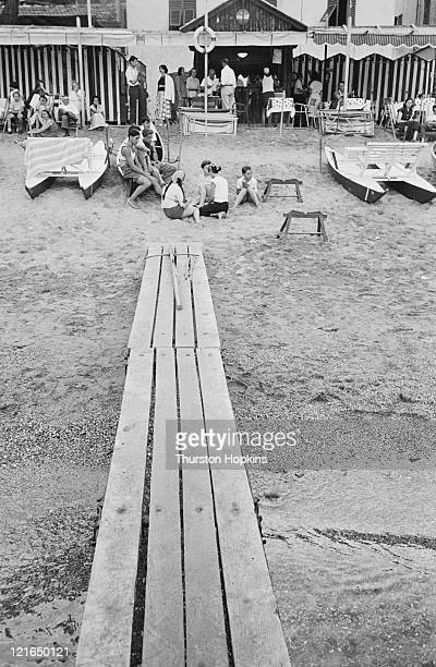 A boardwalk across the sand on Paraggi Beach near the tourist resort of Portofino Italy August 1952 Original Publication Picture Post 6023 unpub
