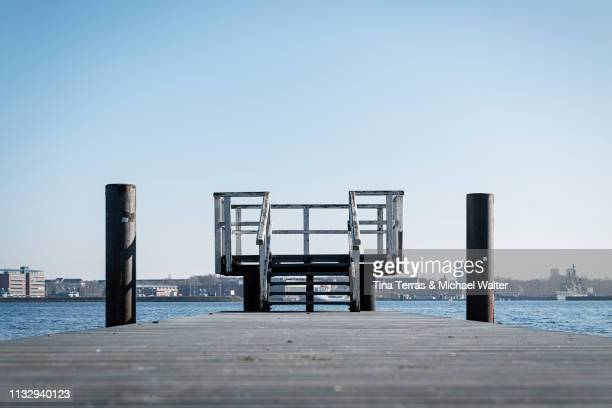 boardwalk at the coast in kiel (germany) - küstenlandschaft stock pictures, royalty-free photos & images