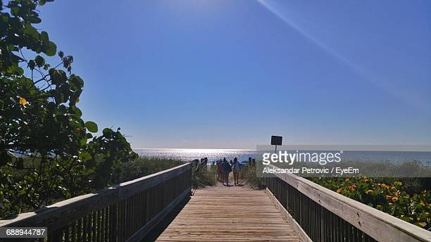 boardwalk by sea against sky - delray beach stock photos and pictures