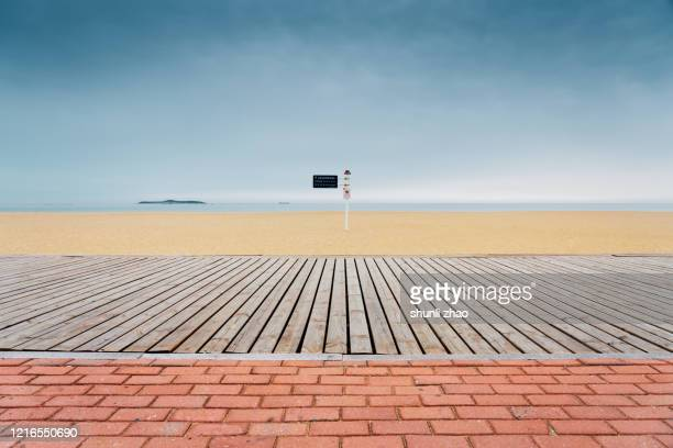 boardwalk by the beach - boardwalk stock pictures, royalty-free photos & images