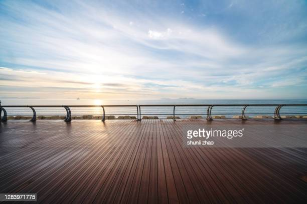 boardwalk by the sea at sunrise - boardwalk stock pictures, royalty-free photos & images