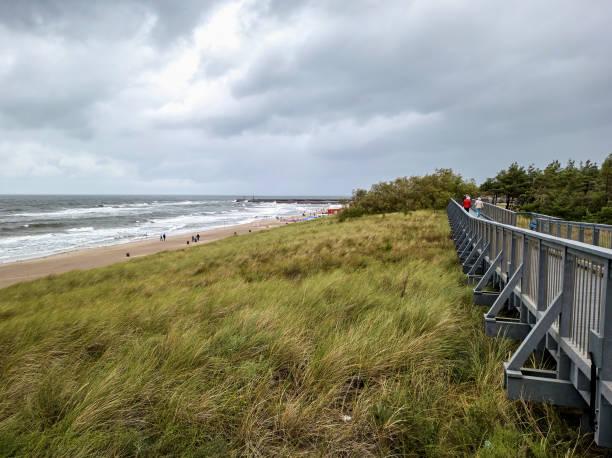 A boardwalk leading along Baltic Sea beach in Darlowo, Poland