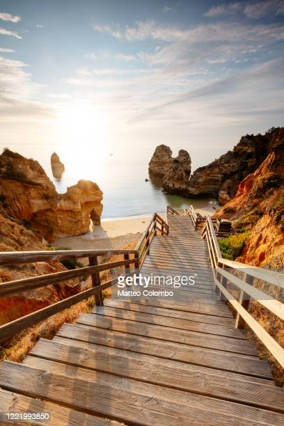 boardwalk leading to camilo beach, algarve, portugal - water's edge stock pictures, royalty-free photos & images