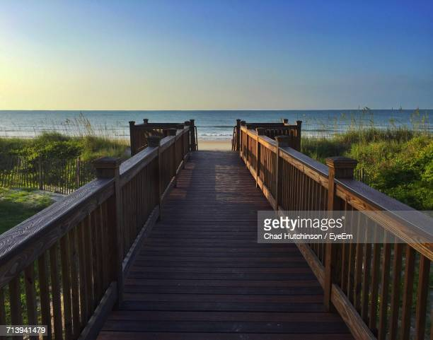 boardwalk leading towards sea against clear sky - file:myrtle_beach,_south_carolina.jpg stock pictures, royalty-free photos & images