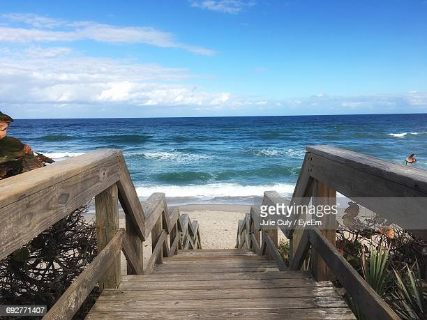 boardwalk on beach against sky - julie culy stock pictures, royalty-free photos & images