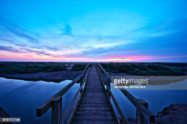boardwalk over salt marsh, stiffkey, norfolk, england, uk - east anglia stock pictures, royalty-free photos & images