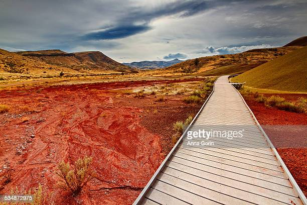 boardwalk through painted hills - painted hills stock pictures, royalty-free photos & images