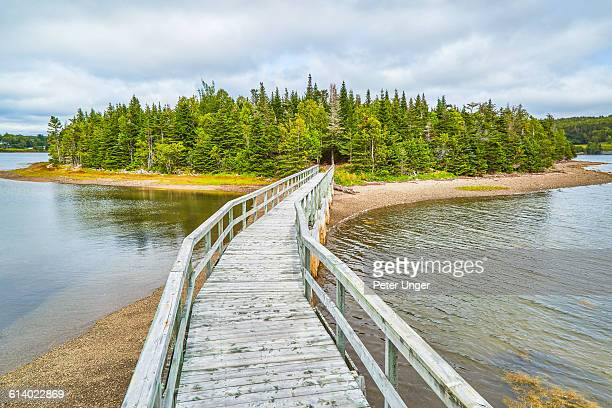 boardwalk to priest island, new brunswick - new brunswick canada stock pictures, royalty-free photos & images