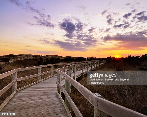 boardwalk to sunset at fire island - long island stock pictures, royalty-free photos & images
