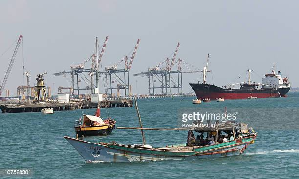 A boast is seen entering the harbour in the southern city of Aden situated at the mouth of the Red Sea on November 30 2010 AFP PHOTO/KARIM SAHIB