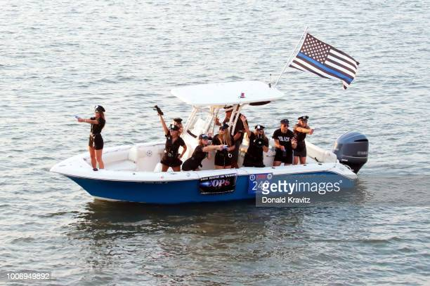 Boat 240 COPS TV show participates in the Ocean City Nitght In Venice Boat Parade at Back Bay of Ocean City on July 28 2018 in Ocean City New Jersey