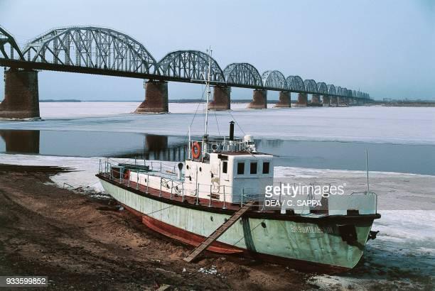 Boat along the Amur river near a railway bridge Khabarovsk Siberia Russia