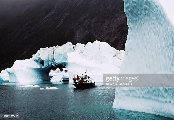 Boat among the icebergs Ice Fjord Narsarsuaq Greenland