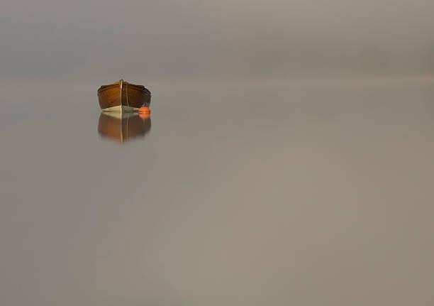 Boat amongst the mist on Scottish Loch