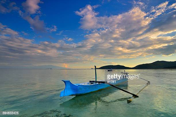 Boat anchored at Jelenga Beach, Sumbawa Island, Indonesia