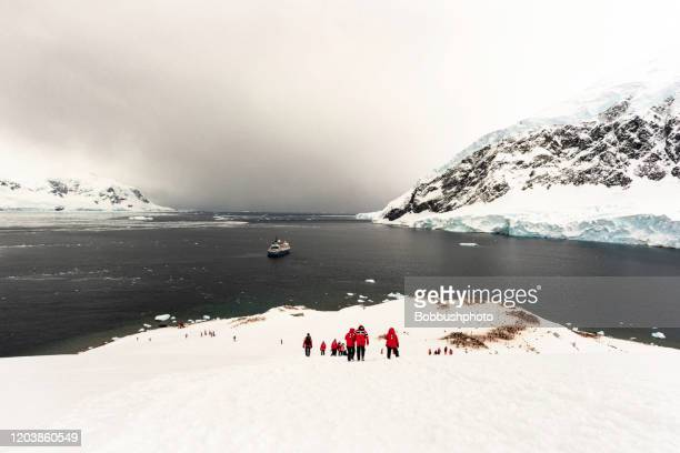boat anchored in neko harbor, andvord bay, antarctic peninsula - antarctic ocean stock pictures, royalty-free photos & images