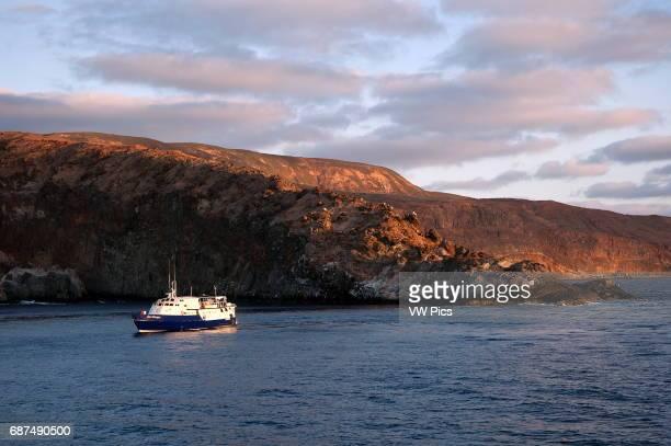 Boat anchored next to Socorro island at sunrise Revillagigedo Mexico