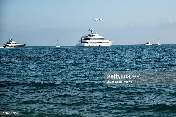 Boat and air plain on the sea