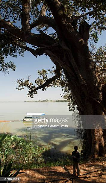 Boat and boy in silhouette at Lake Tana, Ethiopia