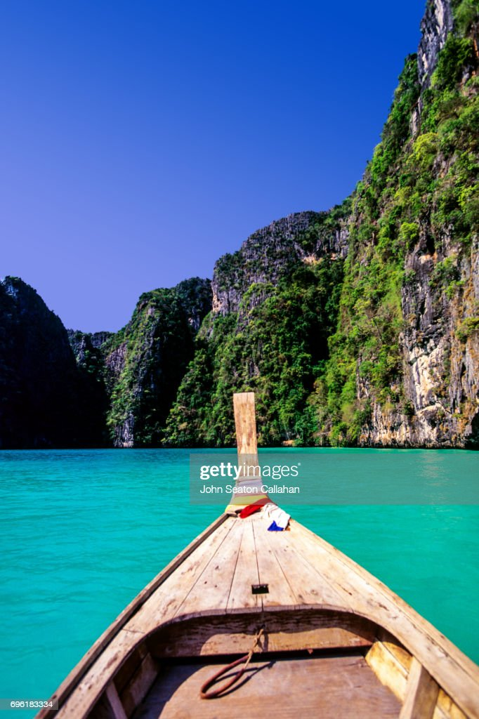 Boat and Karst Cliffs : Stock Photo