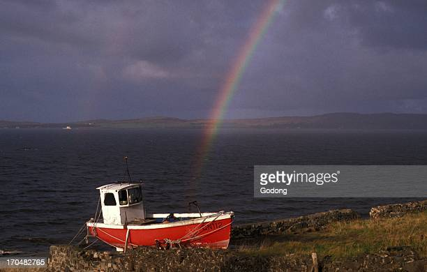 Boat and rainbow on Jura island Scotland Jura Great Britain